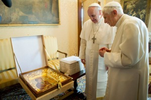 Pope Francis giving Pope Emeritus Benedict XVI an image of Our Lady of Humility.